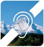 Symbol für Hörbehinderung mit einem Gebirge als Hintergrund